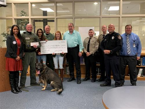 Canine club members pose with CATA administration and members of the Union County Sheriff's Dept.