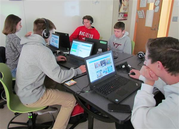 Students work on coding activities