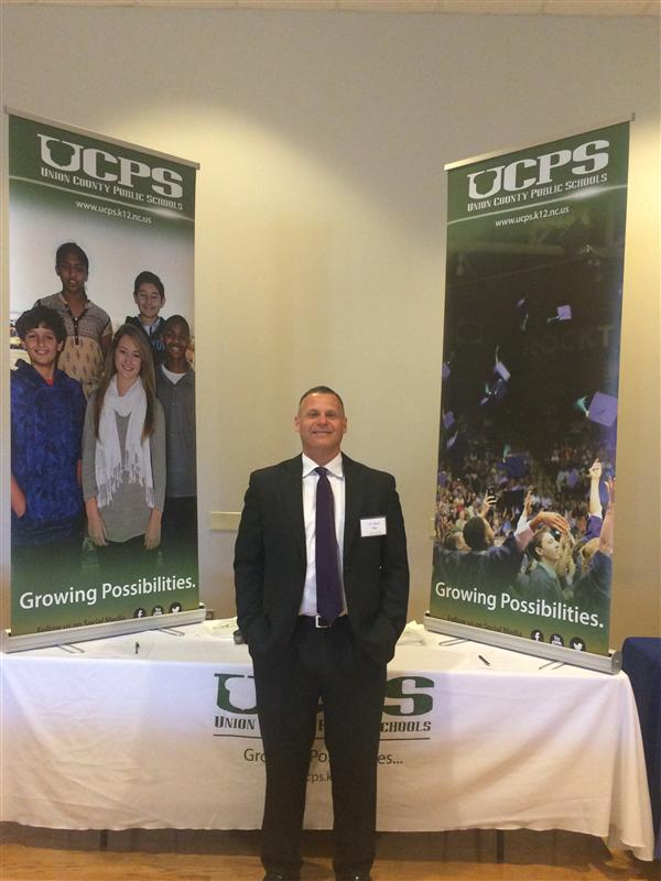 Dr. Kevin Plue, Forest Hills High Principal, exhibits the pride of Union County Public Schools.