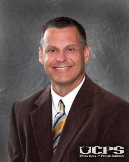 Dr. Kevin Plue, Principal