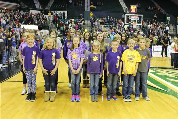 Fairview sings at the Harlem Globetrotters
