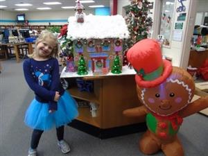 Abbey Snyder with her top winning gingerbread house