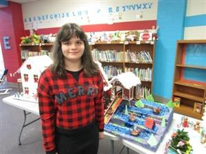 Kayla Carpenter with her top winning Gingerbread House