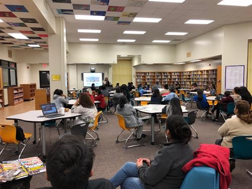 Parents and students in the Forest Hills Media Center for Hispanic College Night