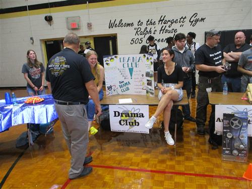 The Drama Club table at the Student Activity Fair was manned by students active in the club.