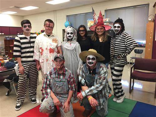 Photo of Beta Club members dressed in scary costumes for the haunted hall.
