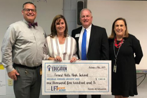 Mrs. Michelle Jordan accepts LIFT Grant check from Union County Education Foundation