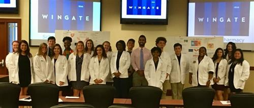 Students from Forest Hills and Monroe in White Coat Ceremony at Levine College of Health Sciences.