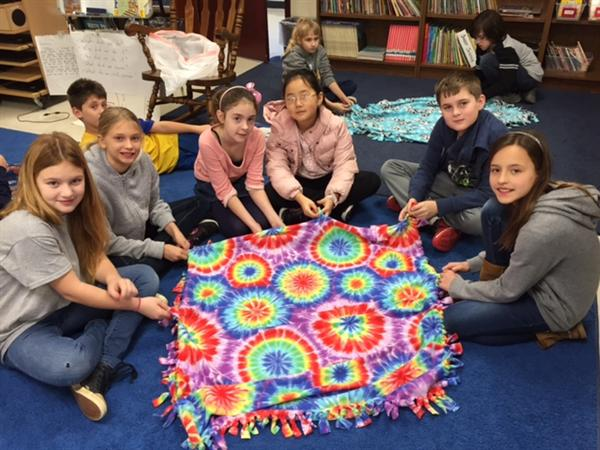 The 4th graders at ITES took donations of new blankets and pajamas to Levine Children's Hospital.