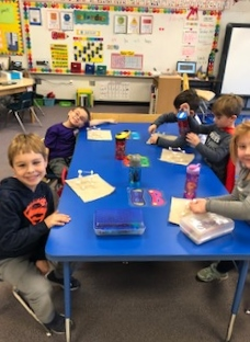 Kindergartners have fun making 3D shapes with marshmallows and toothpicks.