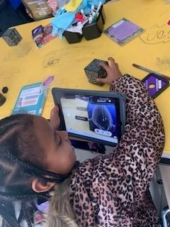 Merge cubes along with apps on iPads allow the students to explore different content.