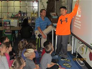 Fourth grader visits a first grade class to talk about living in the Canary Islands.