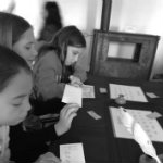Girls learn to write with a quill pen just as the Moravians wrote in Colonial Times.