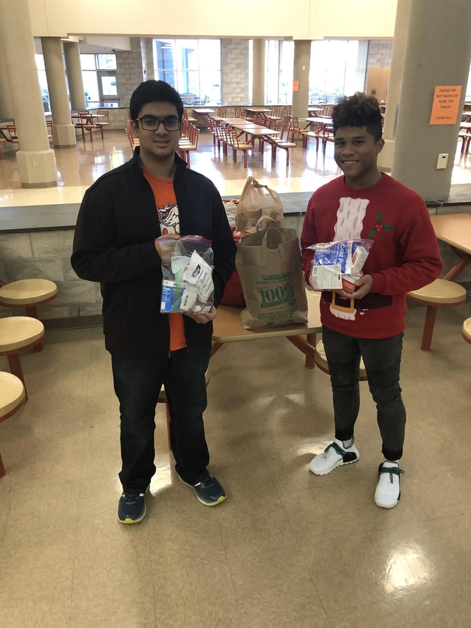 Prabuddha (Co-founder of Aid First) and Christian (President of MRHS HOSA) with two assembled kits.
