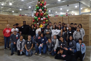 MHS faculty and students help at the Samaritan's Purse Operation Christmas Child processing center.