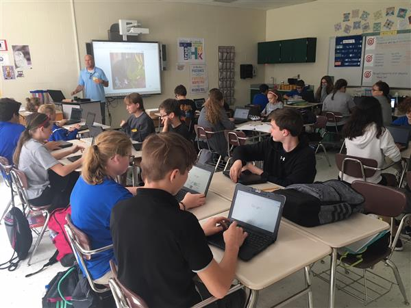 Ms. Johnson's Math 1 students get their first Scratch programming language lesson from Ken Adelglass of Waxhaw Kid Coders