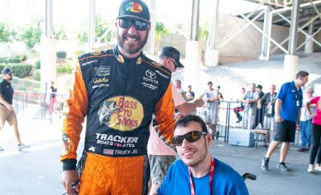 Hunter Adcock posing with Nascar driver.