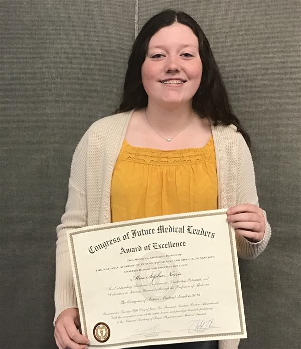 Photo of Sophie Norris with certificate