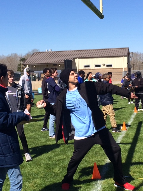 Students competes in the softball throw at the Special Olympics.