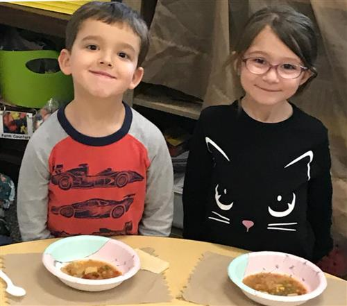 Kindergarteners make Friendship Soup after reading the folktale Stone Soup