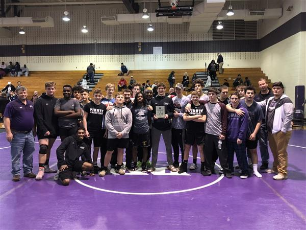 Wrestling team wins conference title again!