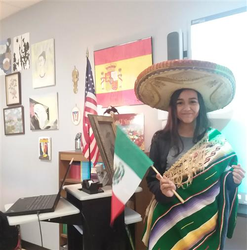 Student dressed in authentic clothing from Mexico.
