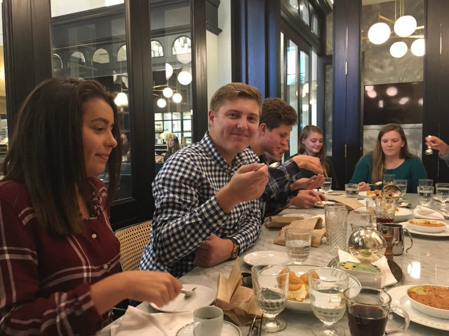 Students enjoy dessert at a French restaurant