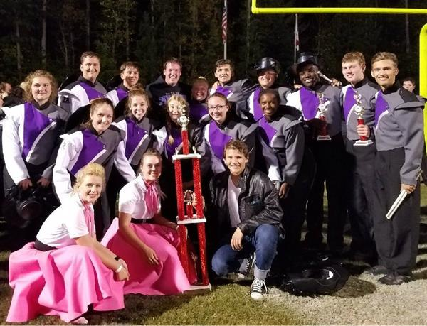 Band leaders pose with grand champion trophy