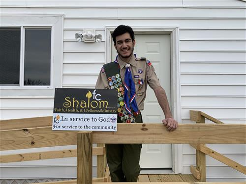 George Boyadjian poses in front of the Shalom Health and Wellness Ministry.