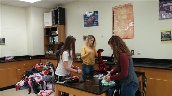 Beta Club students fold pj's for donation