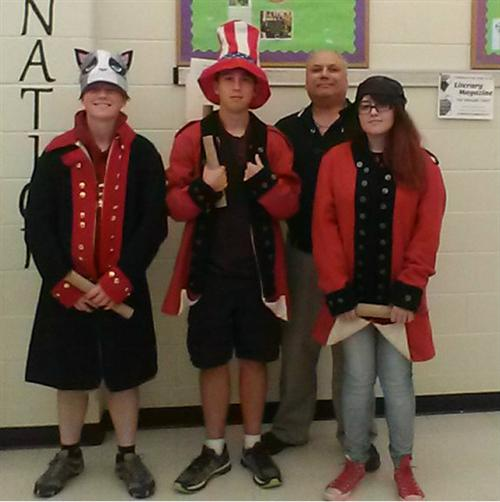 Mr. Korn with students dressed up for reenactment