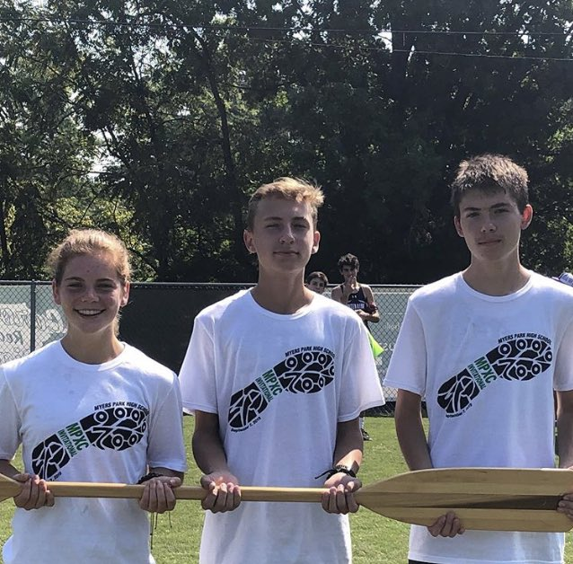Cross Country team members holding the oar.