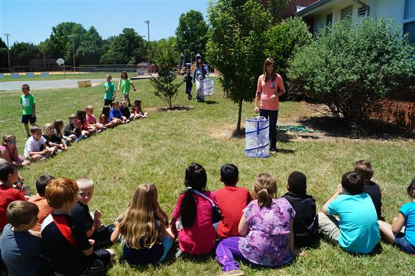 Second grade listens to Mrs. Reed before letting the butterflies go