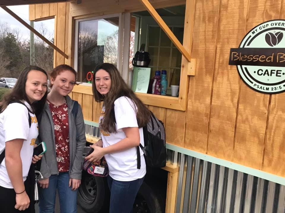 Forest Hills High students' carpentry skills put on display at unveiling of Blessed Beans Mobile Café