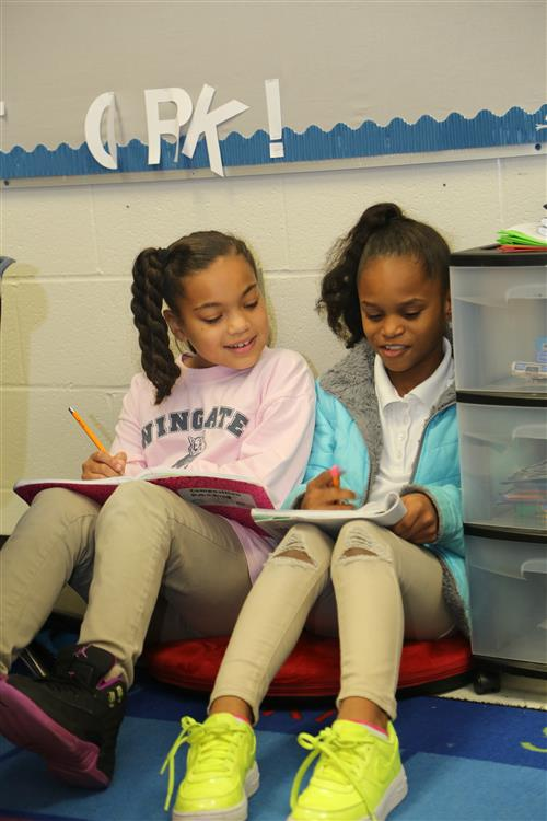 This is a picture of two girls reading.