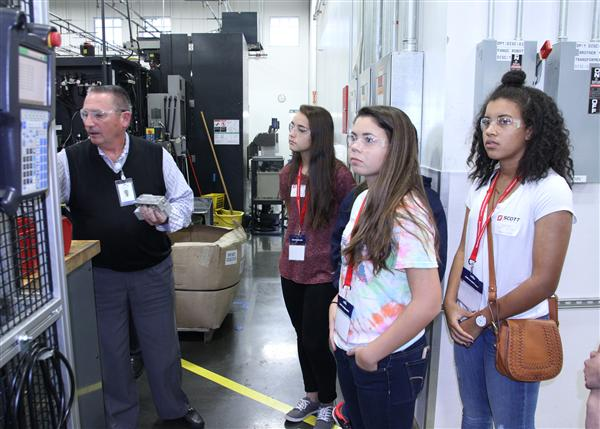 students touring plant