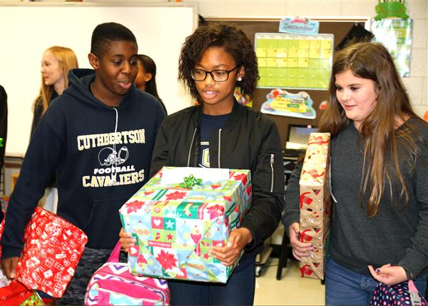 students delivering presents