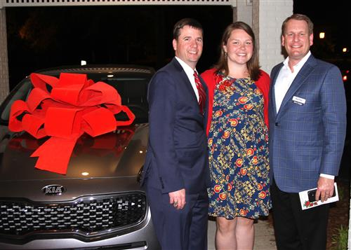 Amanda Stinchcomb stands with her new car