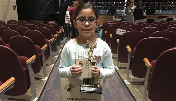 For UCPS Spelling Bee champion Alexia Vega, great spelling skills run in the family