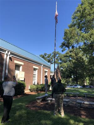 Students work to figure out how y'all the flagpole is.