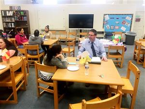 Mr. Campbell talks with a parent