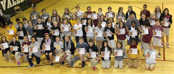 Group of students showing their Honor Roll Certificates