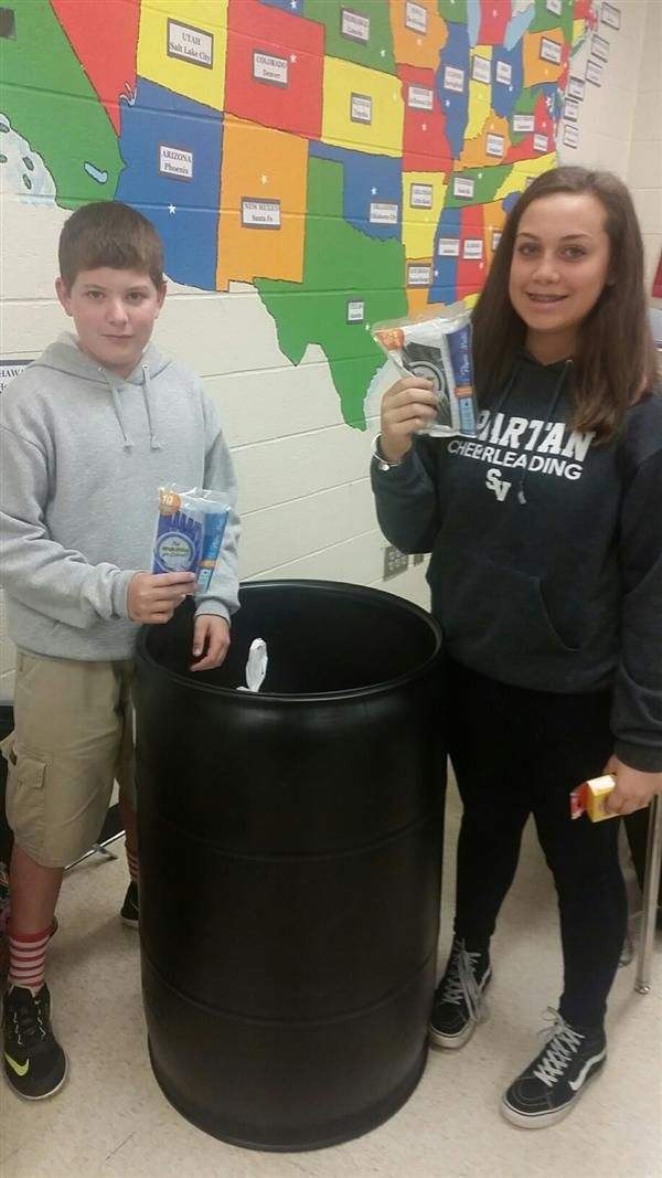 Students packing the barrel for Ghana
