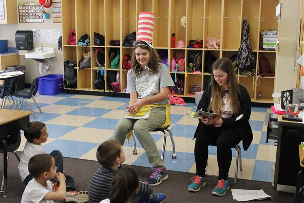 Older students reading to elementary students