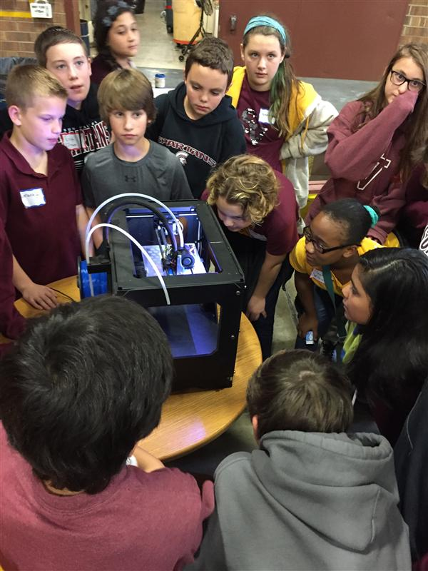 Students watch 3D printer make parts for airplane