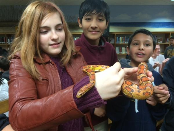 Students handle snake