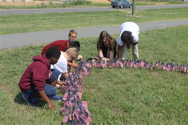 Students plant flags