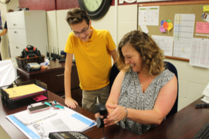 Mrs. Crum shows student how to be an Office Assistant