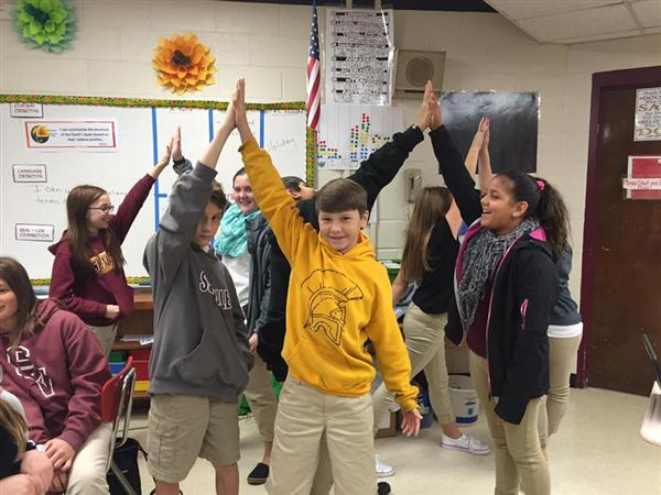 Students high-five each other for Kindness Day