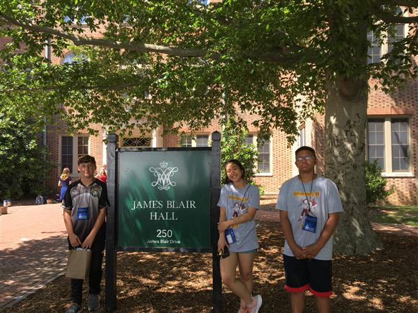 3 students in front of James Blair Hall at William and Mary